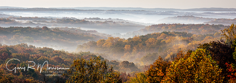 Fall Colors On The Hilltops Peeking Through The Fog Brown County
